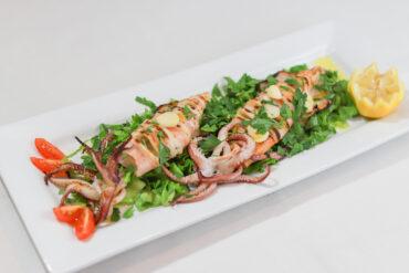 Calamari Fritti - Sliced fresh, flour dusted calamari deep fried to a golden crispy brown