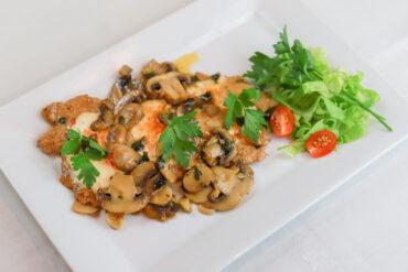 Our Signature Pollo Mamma Lucia- Organic Chicken sautéed in marsala wine with mushroom topped prosciutto, onions with mozzarella